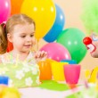 Happy child girl with clown on birthday party — 图库照片