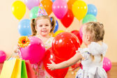 Pretty children with colorful balloons and gifts on birthday par — Stockfoto