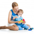 Baby boy and mother playing together with puzzle toy — Stock Photo #13470734