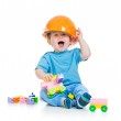 Kid playing with building blocks toy — Stock Photo #13470950