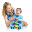 Baby boy and mother playing together with construction set toy — Stock Photo #13470981