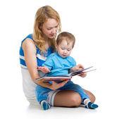 Cute happy kid reading a book — 图库照片