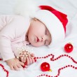 Stock Photo: Sleeping baby girl Santa Claus