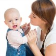 Loving mother playing with her baby — Stock Photo