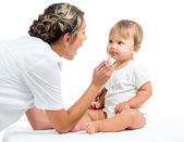 Doctor examining baby isolated on white background — Stock Photo