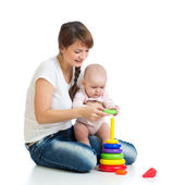 Baby girl and mother playing together with construction set toy — Stock Photo