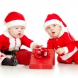 Babies boys in Santa Claus clothes with gift box — Stock Photo #13698814