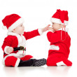 Two funny small kids in Santa Claus clothes isolated on white ba — Stock Photo #13698831