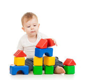 Kid boy playing with construction set blocks isolated on white b — Stock Photo
