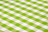 Green checkered tablecloth — Stock Photo