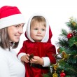 Baby in Santa Claus clothes and mother isolated on white backgro — Stock Photo #13716708