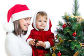 Baby in Santa Claus clothes and mother isolated on white backgro — Stock Photo