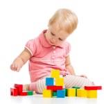 Happy kid playing toy blocks isolated on white background — Stock Photo