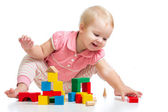 Happy kid playing toy blocks isolated on white background — 图库照片
