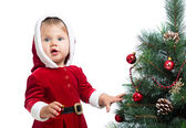Pretty child decorating Christmas tree isolated on white — Stock Photo