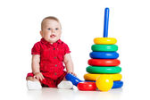 Baby girl playing with big toy isolated on white background — Stockfoto