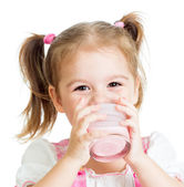 Little child girl drinking yogurt or kefir over white — Stock Photo