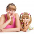 Happy mother and daughter lying on the floor — Stock Photo #14019460