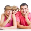 Happy family lying on the floor — Stock Photo