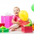 Joyful child girl with colorful balloons and gifts. Isolated on — Stock Photo