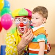 Joyful kid with clown on birthday party — 图库照片
