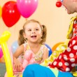 Happy child girl and clown playing on birthday party — Stock Photo