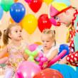 Children girls and clown on birthday party — Stock Photo