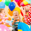 Happy children and clown on birthday party — Foto de Stock