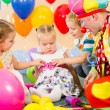 Children and clown on birthday party — Stock Photo