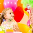 Happy child girl with clown on birthday party — Stock Photo #14139611