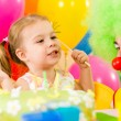 Happy child girl with clown on birthday party — ストック写真