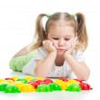 Thoughtful little girl playing with mosaic toy — Stock Photo