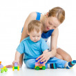 Baby boy and mother playing together with construction set toy — Stock Photo #14435319