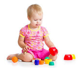Smiling child girl playing with cup toys, isolated over white — Stock Photo
