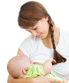 Mother breast feeding and hugging her baby — Stock Photo