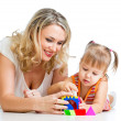 Child girl and mother playing together with puzzle toy — Stock Photo