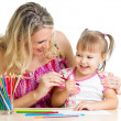 Mother and her child fun games with color pencils — Stock Photo #14743417