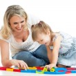 Stock Photo: Baby girl and mother playing together