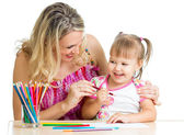Mother and her child fun games with color pencils — Stock Photo