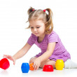 Cute child girl playing with toys isolated over white — Stock Photo