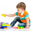 Kid boy playing with construction set over white background — Stock Photo #15709461