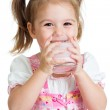 Kid drinking yoghurt from glass — Stock Photo
