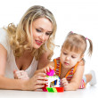 Child girl and mother playing together with puzzle toy — Lizenzfreies Foto