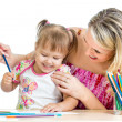 Mother and her child fun games with color pencils — Stock Photo #15709491