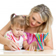 Stock Photo: Mother and her child fun games with color pencils