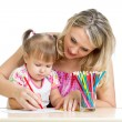 Mother and her child fun games with color pencils — Stock Photo #15709493