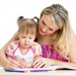 Little child with mother drawing with color pen over white — Stock Photo