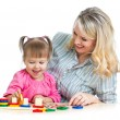 Mother and her child playing with colorful puzzle toy — Stock Photo