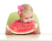 Little girl eating watermelon isolated on white background — Stock Photo