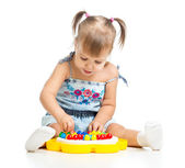 Cute child playing with mosaic toy — Stock Photo